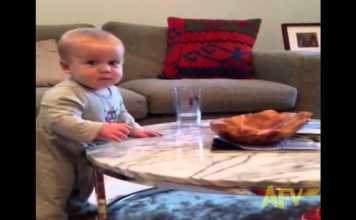 Baby Can't Resist Knocking Over A Glass Of Water