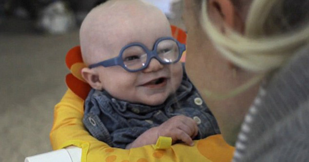 glasses-baby-sees-mother-first-time-smiles-4