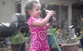 Little Girl With A Water Hose Makes A Bad Decision