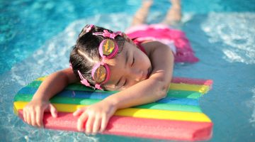 Girl_with_styrofoam_swimming_board